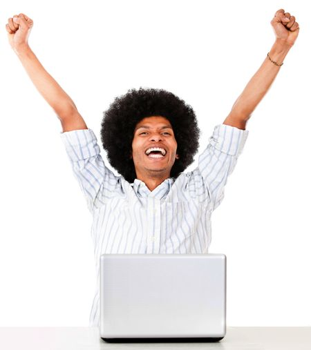 Successful man on a laptop computer - isolated over a white background