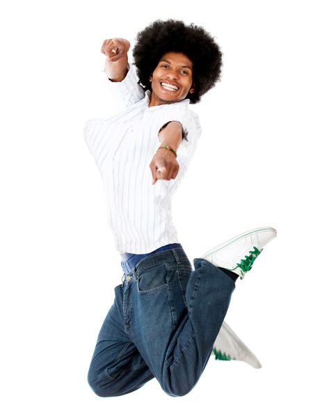 Happy man jumping and pointing at the camera - isolated over white