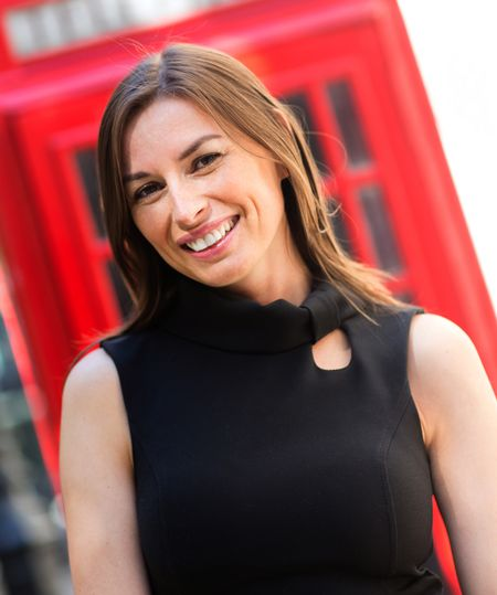 Successful business woman in London looking happy