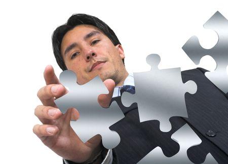 business man arranging puzzle pieces