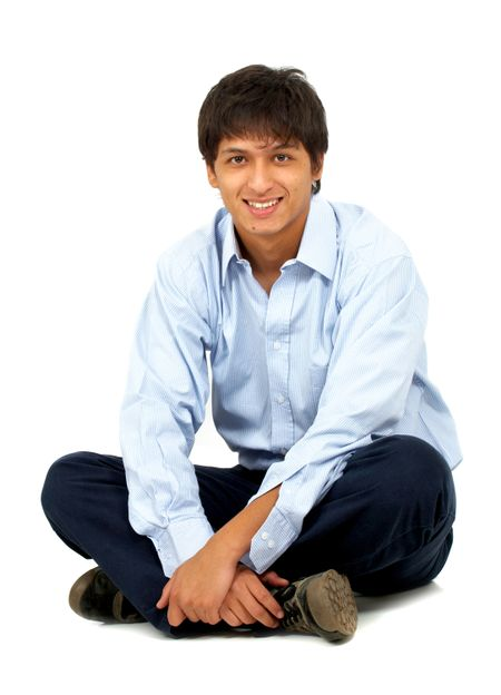 casual man sitting on the floor isolated over a white background