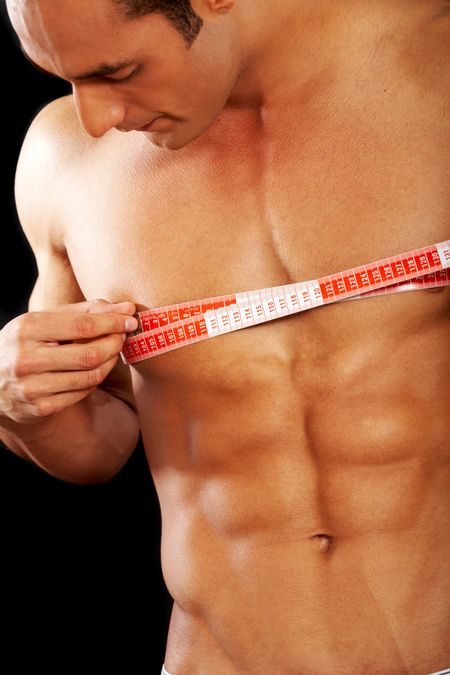 man with a muscular body measuring his chest - lose weight series