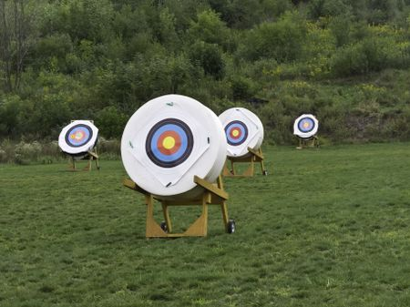 Four movable targets at back of archery range