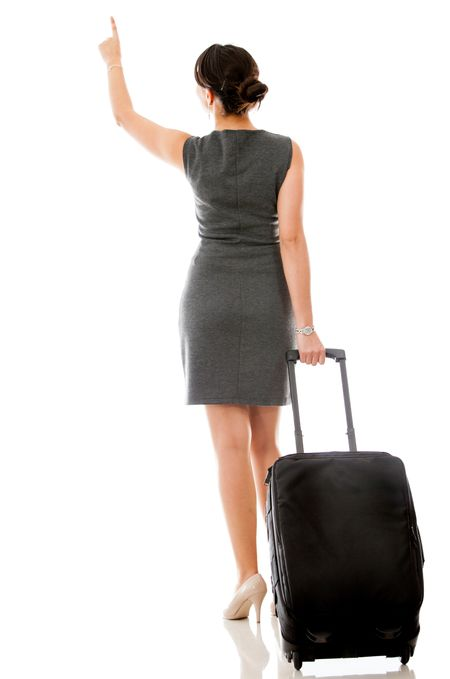 Woman on a business trip pointing with her finger - isolated