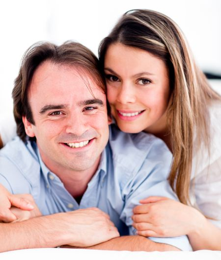 Affectionate couple smiling at home looking very happy