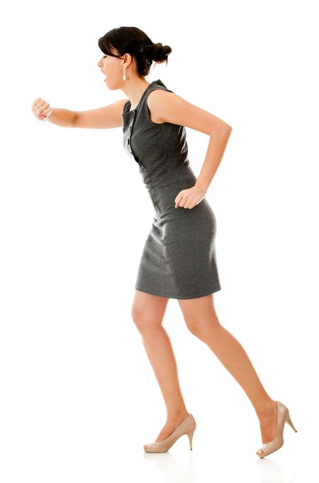 Business woman in a hurry - isolated over a white background