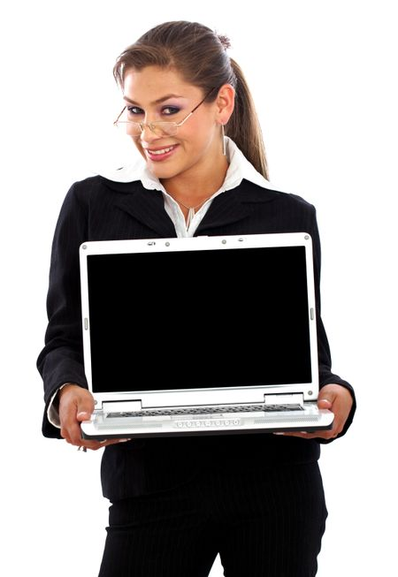 business woman displaying a laptop - isolated over a white background