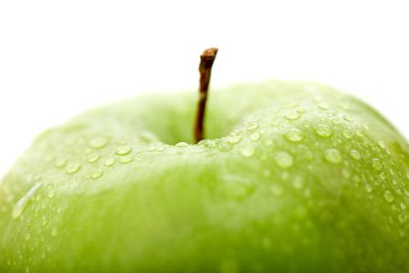 green apple close up with water drops isolated over a white background