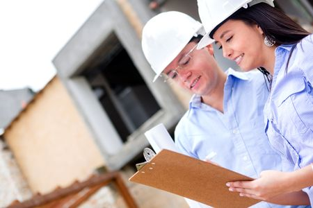 Workers in a construction site talking about a house project