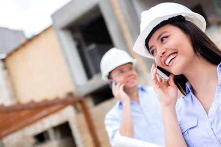Engineers talking on the phone at a construction site