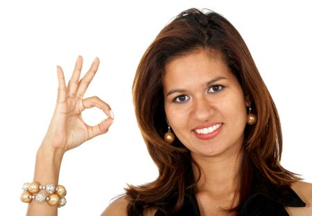 business woman doing the ok sign smiling - isolated over a white background