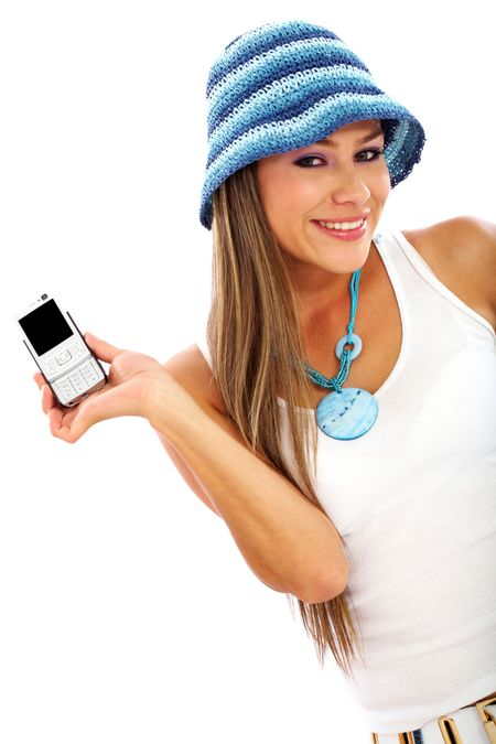 casual happy girl smiling and showing her mobile phone isolated over a white background