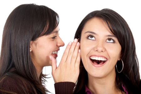 girl telling a secret to another - gossip isolated over a white background