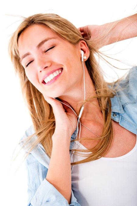 Woman relaxing and listening to music - isolated over a white background