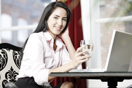 Attractive woman working on her laptop catching up after a long day.