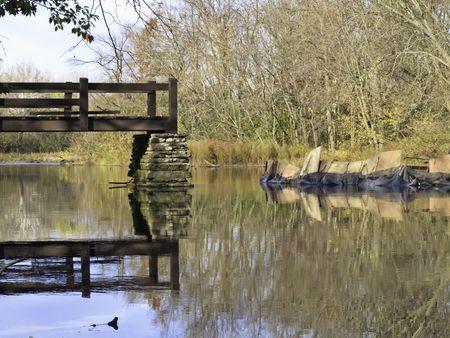 Making ends meet for public enjoyment: Early stage of reconstruction of footbridge across Salt Creek, Oak Brook, Illinois, in autumn