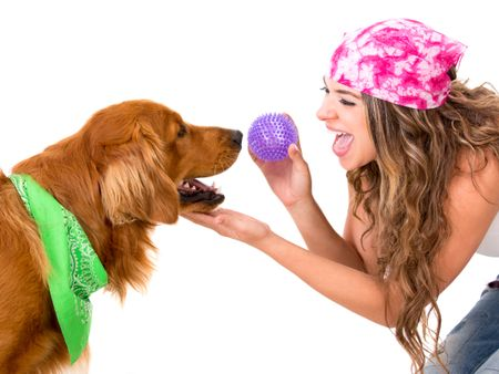 Woman playing with her dog throwing the ball - isolated over white