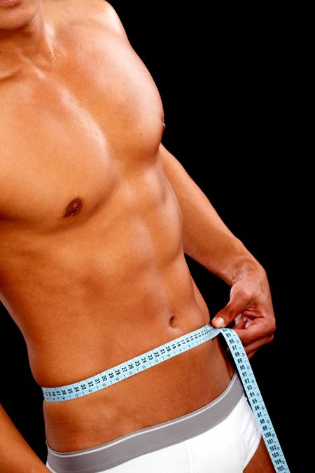 man with a muscular body measuring his abs - lose weight series