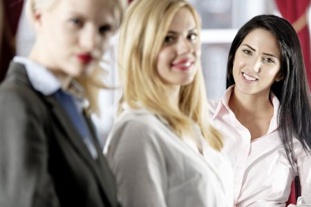 Three attractive female work colleagues together