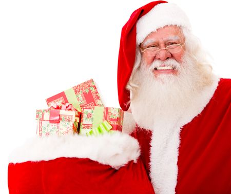 Happy Santa with Christmas gifts in a sack - isolated over white