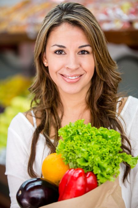 Healthy female shopping buying fresh groceries