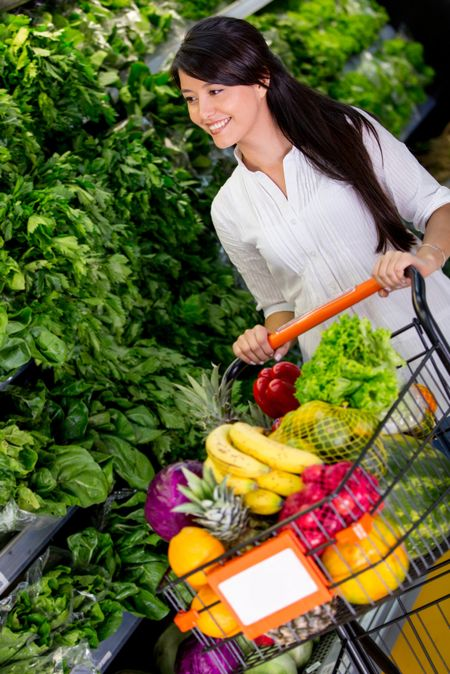 Woman shopping organic groceries at the supermarket