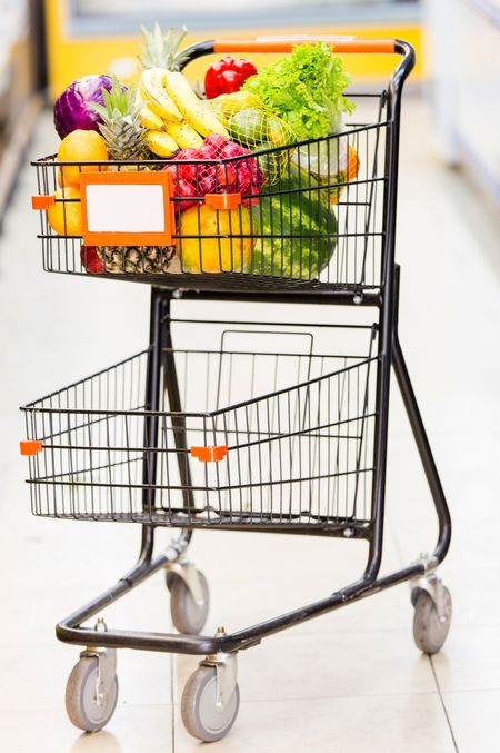 Shopping trolley full of fresh fruits and vegetables