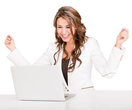 Succesful businesswoman with a laptop and arms up - isolated over white