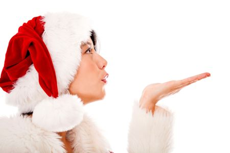 Mrs Claus blowing Christmas kisses - isolated over a white background