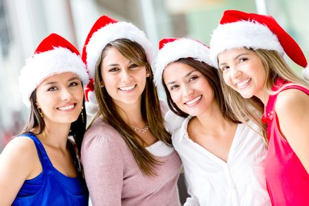 Group of happy Christmas women wearing Santas hat