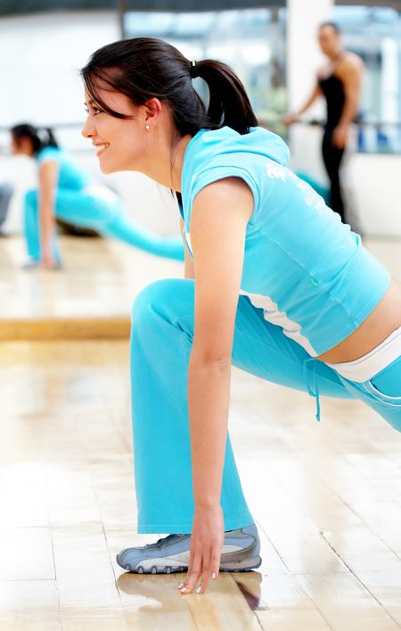 beautiful woman at the gym doing stretching exercise