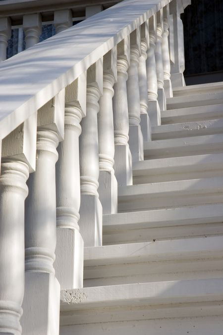 Balustrade to old house in morning sunlight