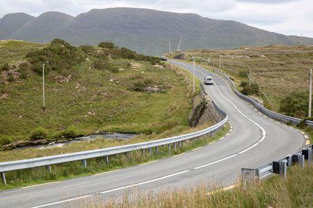 Car on Open Road near Killary Fjord; Connemara National Park; Ireland