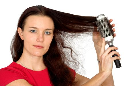 beautiful female model combing her hair over a white background