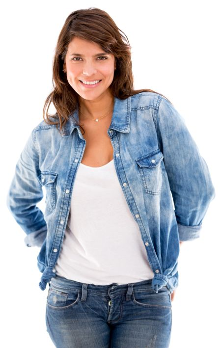 Beautiful woman in denim and smiling - isolated over white