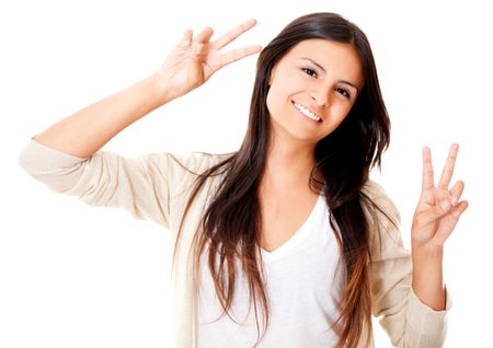 Fun woman making a peace sign - isolated over white