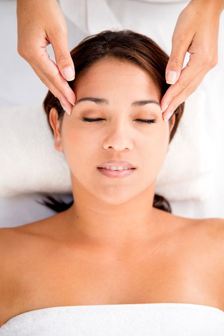 Woman enjoying a relaxing massage at the spa