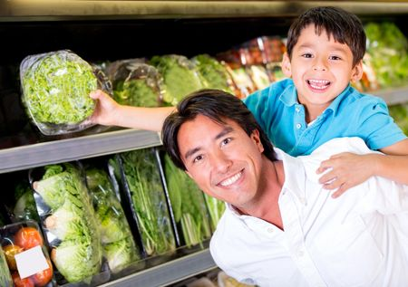 Father and son buying groceries at the supermarket