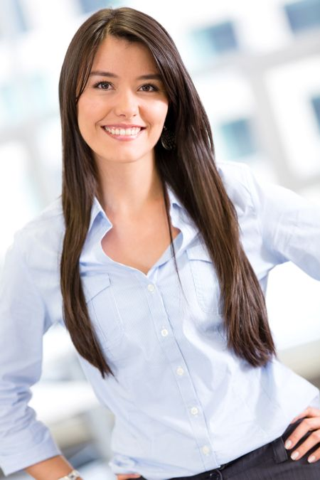 Beautiful business woman smiling at the office