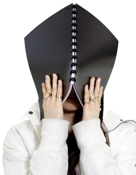 no more studying! - teenager with a notebook on her head