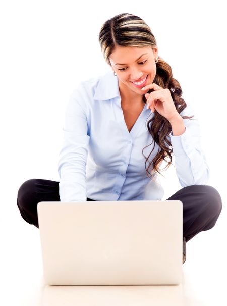 Businesswoman working online on a laptop - isolated over white