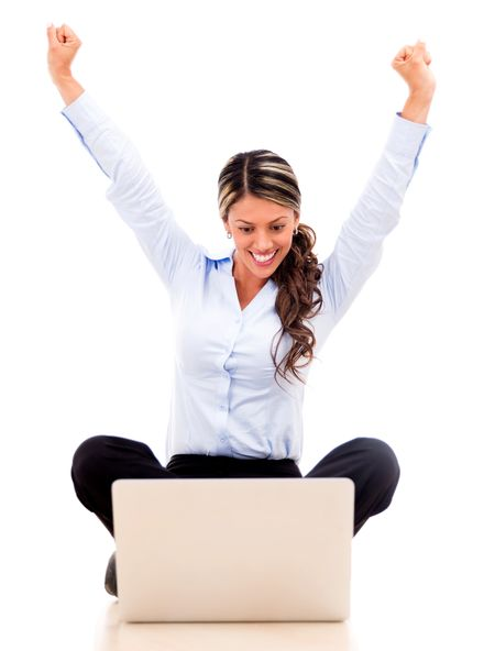 Business woman enjoying her online success - isolated over white