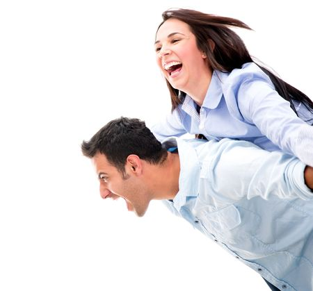 Excited couple looking very happy - isolated over a white background