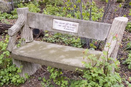 Garden bench with quotation from Shakespeare's Hamlet