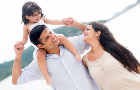 Loving family enjoying their time at the beach