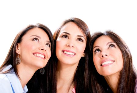 Three pensive women looking up - isolated over a white background