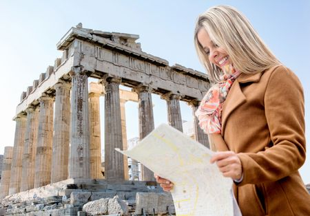 Woman on holidays holding a map in Athens, Greece