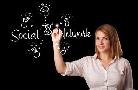 Young woman draving social network theme on whiteboard