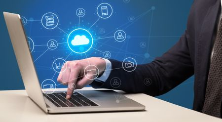 Businessman hand typing with cloud technology system and office symbol concept