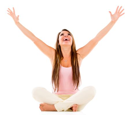 Excited woman with arms open - isolated over a white background